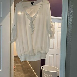 White blouse with ruffles puff sleeves